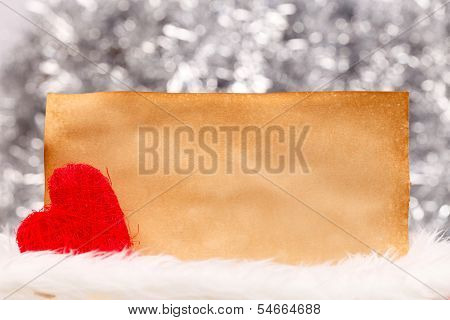 String red heart near empty old paper bokeh background poster
