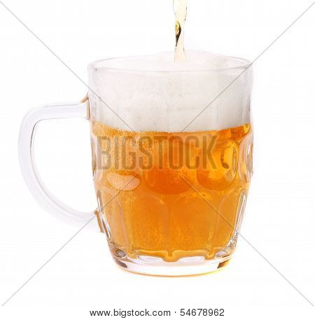 Pouring a pint of beer, isolated on white.
