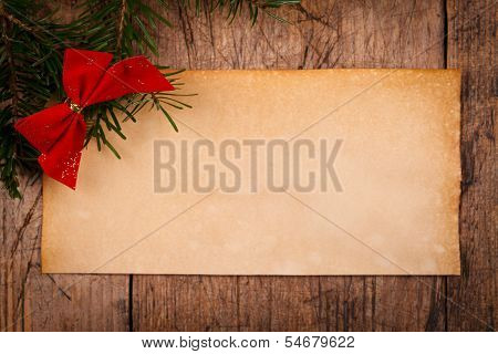 Wooden Background With Christmas Ornaments And Old Paper