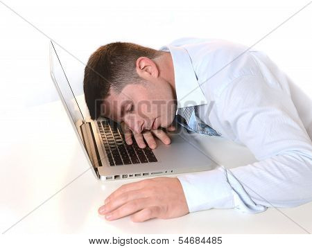 Stressed  Overworked Businessman Sleeping Over Keyboard