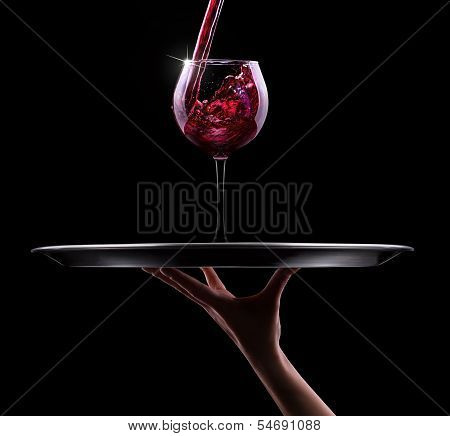glass of red wine on a black