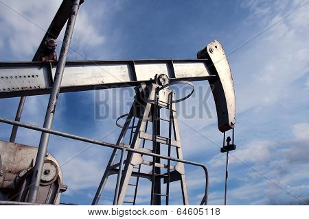 Silver Pumpjack In Crude Oil Field Mine