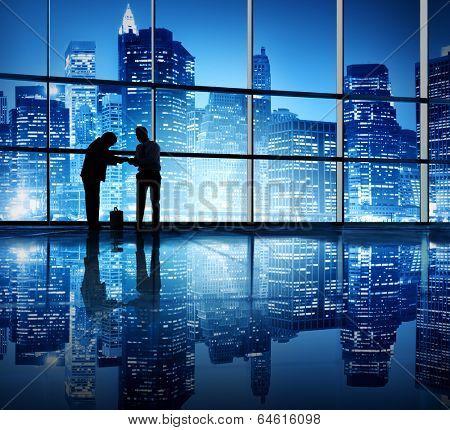 Two businessmen bonding in an office building.