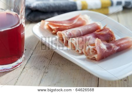 plate of cured ham on wooden background poster