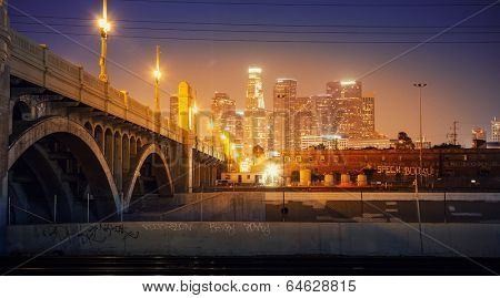 City of Los Angeles at night. Scenic view of downtown skyline with bridge in foreground.