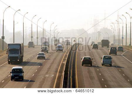 MINSK, BELARUS - NOVEMBER 3: Cars run down on ringway in thick smog November 3, 2011 in Minsk, Belarus.