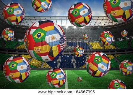 Footballs in international flags against large football stadium with brasilian fans
