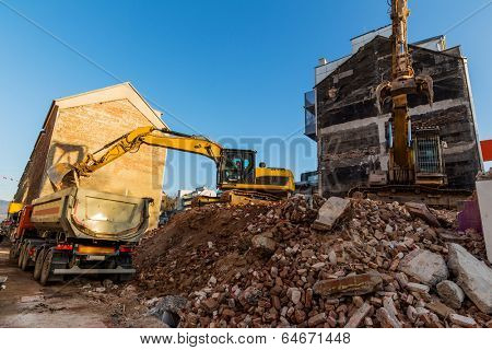 excavator on a construction site during the demolition of a hauses.platz for new housing and living space is required