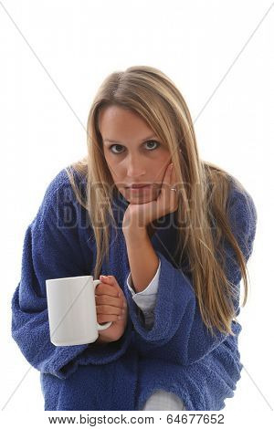 Sick girl in housecoat with a cup of tea