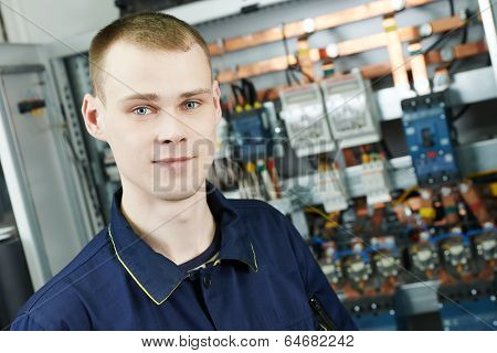 electrician engineer worker inspector in front of fuseboard equipment in room poster