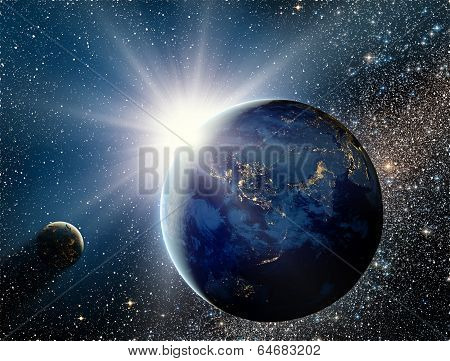 Sunrise Over The Planet And Satellites In Space.
