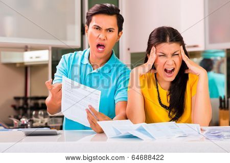 Young Asian handsome couple fighting and shouting because of financial dept and unpaid bills due