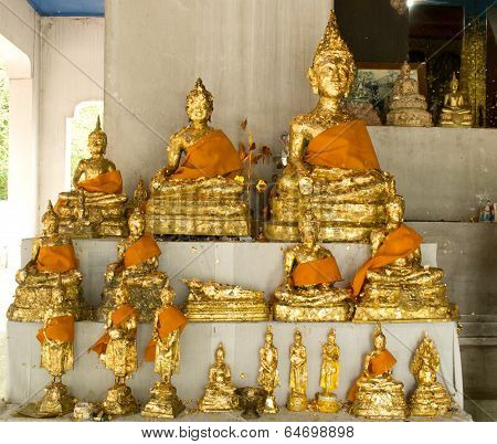 The Buddha statue with gold leaf at Thai temple