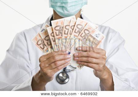 Female Doctor Holding Money