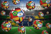 Footballs in international flags against large football stadium with brasilian fans poster