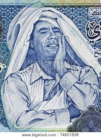 LIBYA - CIRCA 2004: Muammar Gaddafi (1942-2011) on 1 Dinar 2004 Banknote from Libya. Ruler of Libya during 1969-2011.