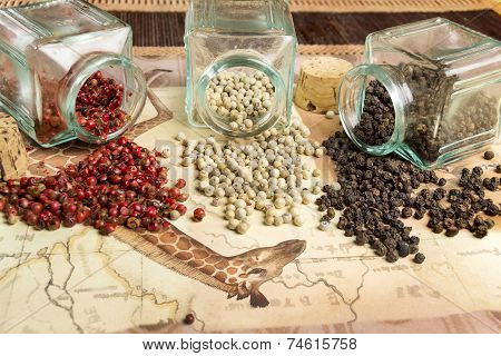 pink, white and black pepper in their glass container
