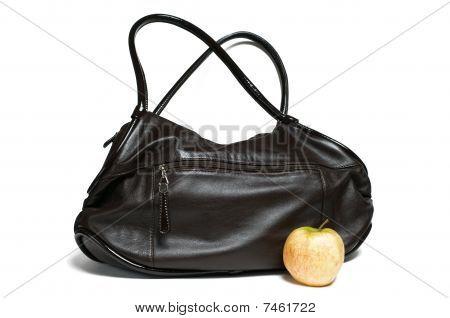 Female Bag And An Apple