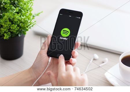 Girl Holding Iphone 6 Space Gray With Service Spotify