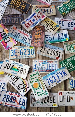 BAR HARBOR, MAINE - AUGUST 28: Old car license plates on a wall in Bar Harbor. In the United States, each jurisdiction has a unique design, usually displaying symbols of the issuing state. August 28 2014