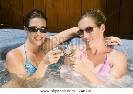 Two Young Women Relaxing In A Jacuzzi