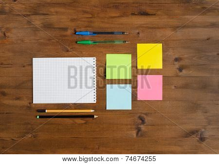 Set of office supplies on old wooden table poster