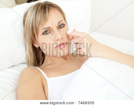 Sick Woman Lying On Her Bed