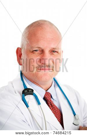 Portrait of a handsome, mature medical doctor looking friendly but serious.  White background