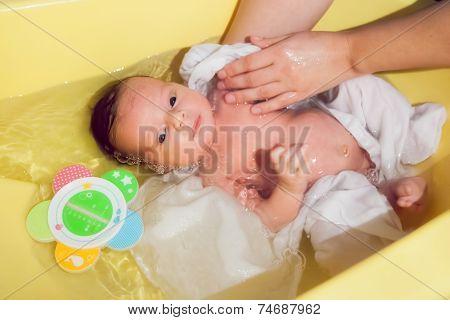 Newborn Baby Taking A Bath