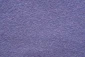 abstract fluffy texture of soft knitted fabric from a wool yarn with a pattern in the form of a herringbone for backgrounds of violet color poster