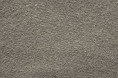 abstract fluffy texture of soft knitted fabric from a wool yarn with a pattern in the form of a herringbone for backgrounds of beige gray color poster