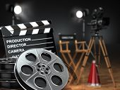 Video, movie, cinema concept. Retro camera, reels, clapperboard and director chair. 3d poster