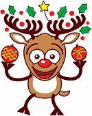 Enthusiastic brown reindeer with big antlers, decorated with a yellow star and evergreen holly leaves, and red nose while holding two beautifully decorated Christmas baubles poster