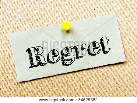 Recycled paper note pinned on cork board. Regret Message. Concept Image poster