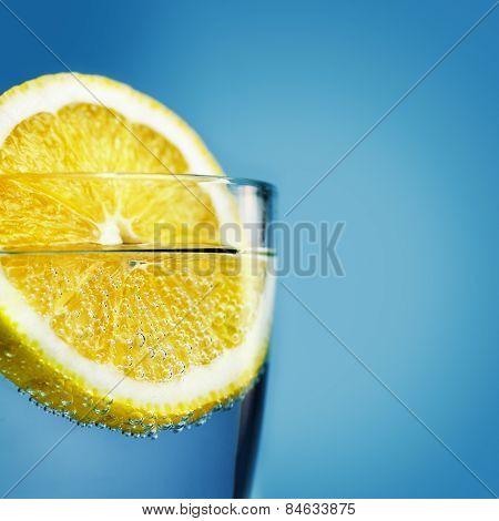 Sliced Lemon In Glass Of Water