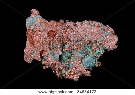 Native copper from above over black background. Freshly exposed metal surface with reddish-orange color embedded in green turquoise mineral. Chemical element Cu. poster