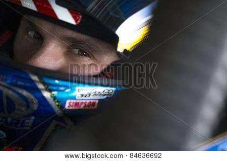 Daytona Beach, FL - Feb 14, 2015:  Trevor Bayne (6) straps into his car before a practice session for the Daytona 500 at Daytona International Speedway in Daytona Beach, FL.