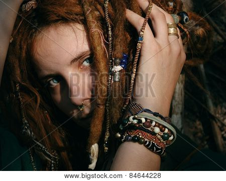 Close up Gorgeous Young Woman with Stylish Bracelets Touching her Hair While Looking at the Camera.
