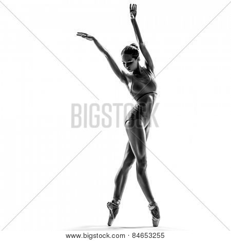 female dancer ballerina posing on white isolated studio background. high contrast black and white image