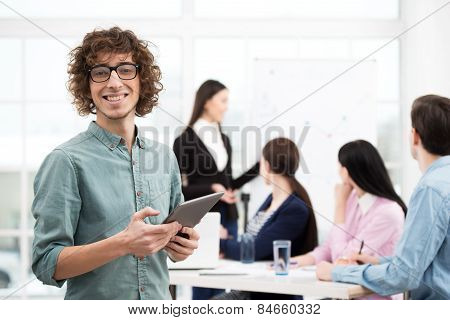 Creative businessman with tablet computer in office