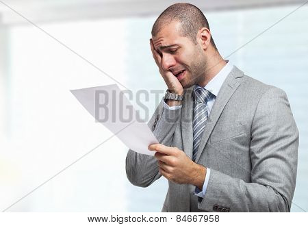 Portrait of a stressed businessman reading a document