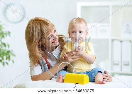 Doctor Holding Inhaler Mask For Child Breathing