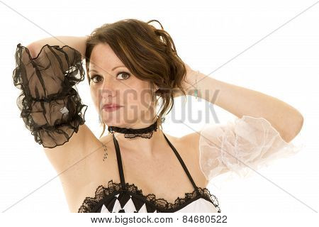 Woman In Costume Arms Behind Head Looking