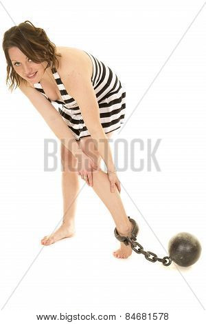 Woman In Prison Outfit Skirt With Ball And Chain On Foot