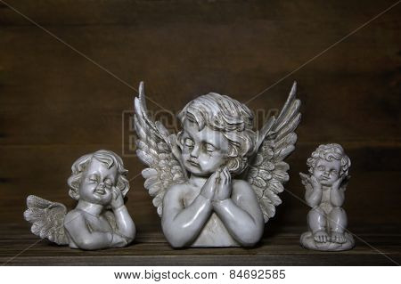 Three sad angels: decoration for bereavement.