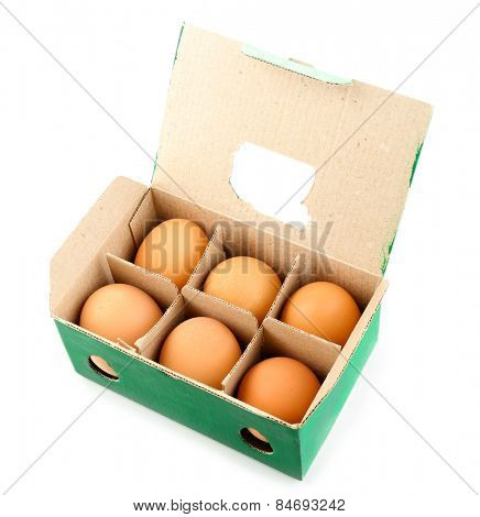 Egg box with six brown eggs isolated on white
