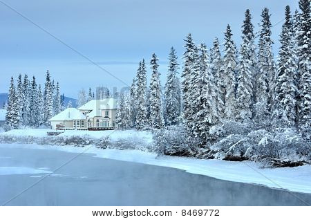 House on an Alaska River in Winter