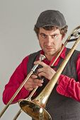 Trombone musician takes a moment to be angry at his audience poster