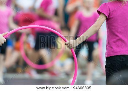 Hula hoop exercises at school.