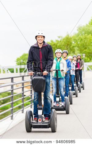 Tourist group having guided Segway city tour in Germany